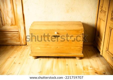 Retro style. Old wooden chest like treasure box in the attic. Interior. - stock photo