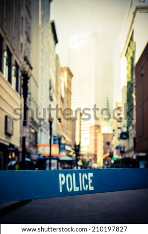 Retro Style Photo Of A Police Barrier At A Crime Scene In A City Street - stock photo