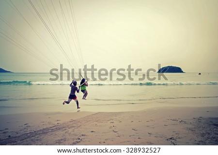 Retro Style Photo Vintage Parasailing at Patong Beach in Phuket - Thailand extreme Sports - stock photo