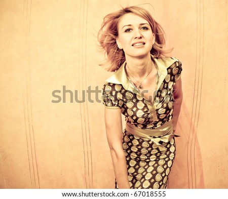 Retro style Portrait of a fresh and lovely woman with magnificent hair - stock photo
