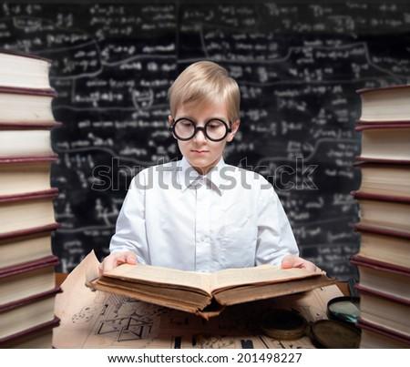 Retro style portrait of a studying boy - stock photo