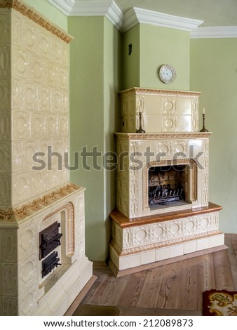 Retro style room with two tiled stoves - stock photo