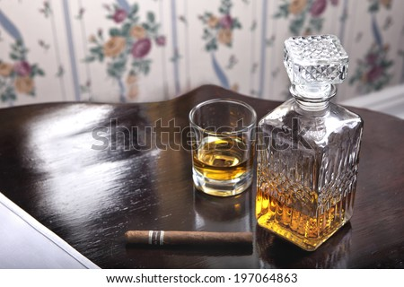 Retro style - scotch whiskey, botlte, glass of whiskey and cigar - stock photo