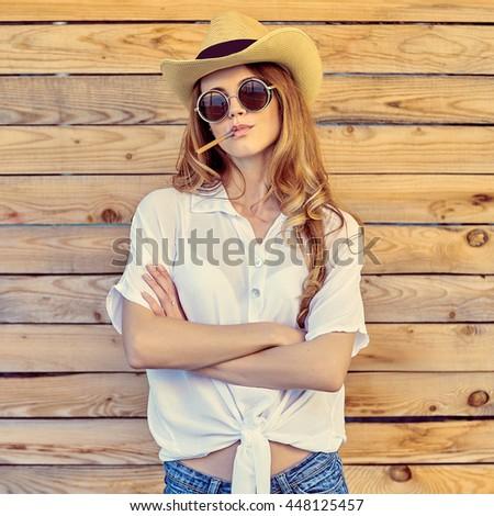 Retro style smoking fashion woman portrait - stock photo