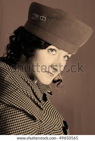 Retro-style woman in sepia - stock photo