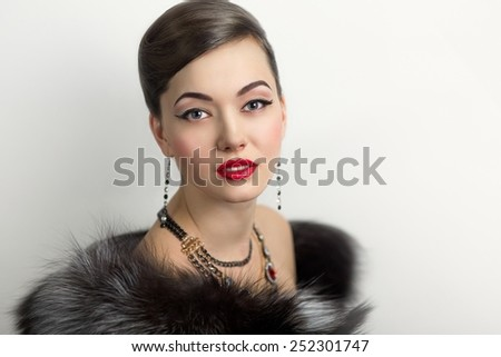 Retro style woman portrait perfect face, professional make up bright red lips, big eyes, sexy shoulders, expensive jewelry necklace earrings, stylish hair dress. Vip person one million baby love money - stock photo