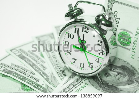 Retro styled alarm clock covered pile of money isolated on white. Time is money concept , dollars, euro - stock photo