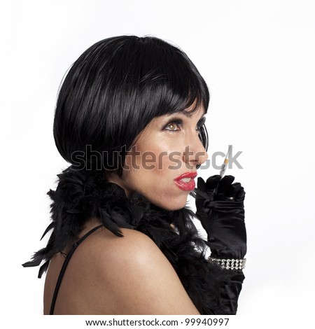 Retro styled fashion portrait of a young woman - stock photo