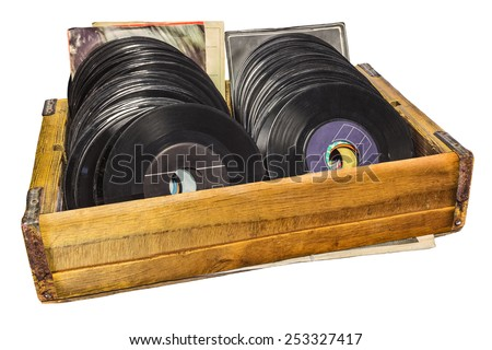 Retro styled image of a wooden box with vinyl turntable records isolated on a white background - stock photo