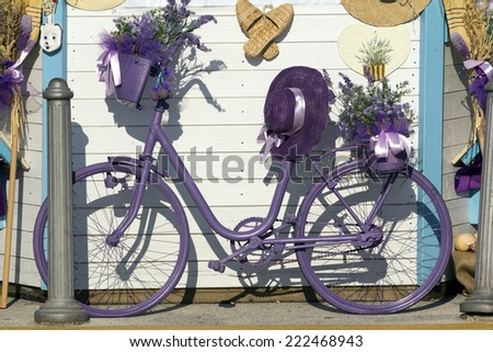 Retro styled old bicycle painted in purple. - stock photo