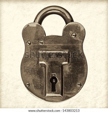 Retro styled sepia image of an antique brass padlock - stock photo