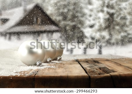 retro table place and three balls on snow decoration  - stock photo
