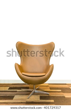 Retro tan leather chair and side table with flowers interior - stock photo