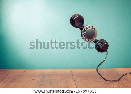 Retro telephone handset with rotary disk for old style background concept - stock photo