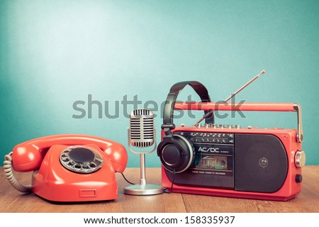 Retro telephone, radio and cassette player, headphones, microphone - stock photo