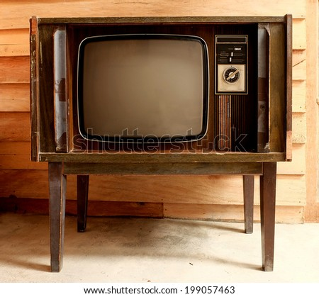 Retro television in cover wood in front wall. - stock photo