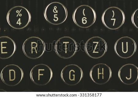 Retro toned vintage typewriter keys detail, close up with selective focus, top view - stock photo