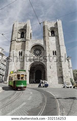 retro tram on the street in Lisbon, Portugal - stock photo