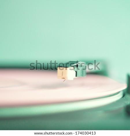 Retro turntable with pink vinyl  - stock photo