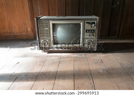 retro tv with wooden case in room - stock photo