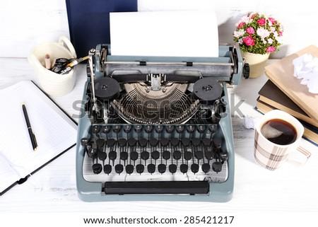 Retro typewriter on wooden background - stock photo