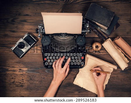 Retro typewriter placed on wooden planks. Aerial angle of view - stock photo