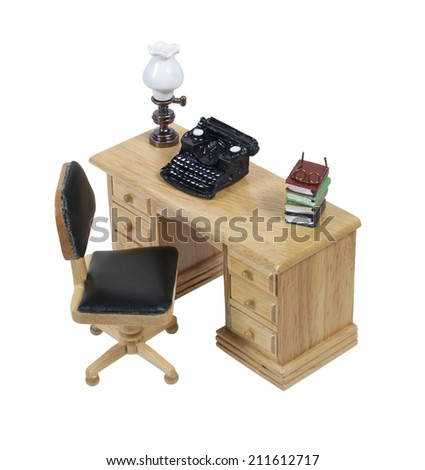 Retro typewriter used for typing up documents with a lamp and books on a desk - path included - stock photo