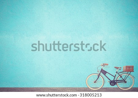 retro vintage bicycle old and blue wall background design - stock photo