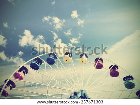 Retro vintage filtered picture of a carousel, concept background. - stock photo
