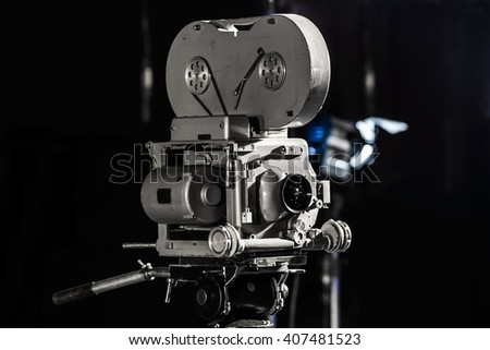 Retro vintage movie camera  in pavilion - stock photo