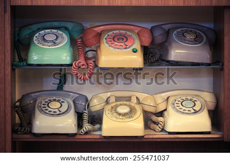 Retro, Vintage, Old telephone on wood table - stock photo