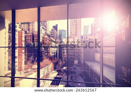 Retro vintage stylized picture of Manhattan with flare effect, New York City, USA. - stock photo