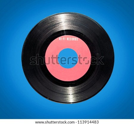 Retro vinyl record on blue background - stock photo