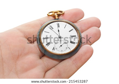 Retro watch in hand isolated on white background - stock photo