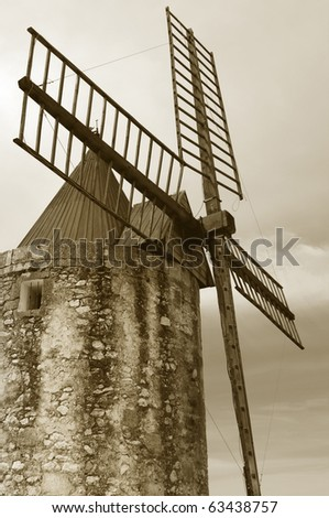 """Retro windmill: where the famous french writer Alphonse Daudet wrote his: """"Lettres de mon moulin"""". Provence region of France. Desaturated and sepia toned for retro look. - stock photo"""