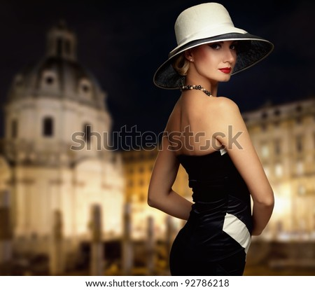 Retro woman against night city. - stock photo