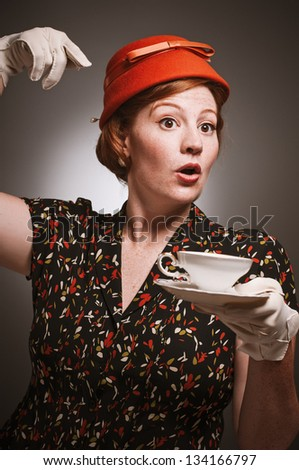 Retro woman beckoning service for more tea - stock photo
