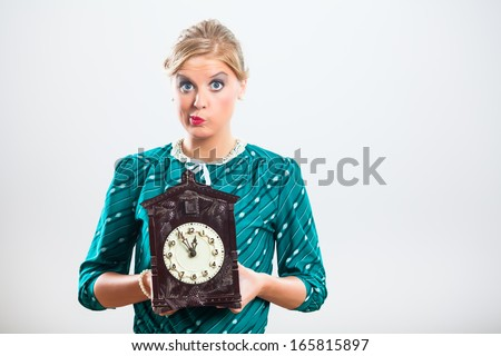 Retro woman is holding old fashioned clock and thinking  how quickly time passes,Time - stock photo