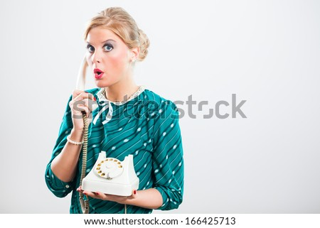 Retro woman is surprised because of something she heard on the phone,Gossip on the phone - stock photo
