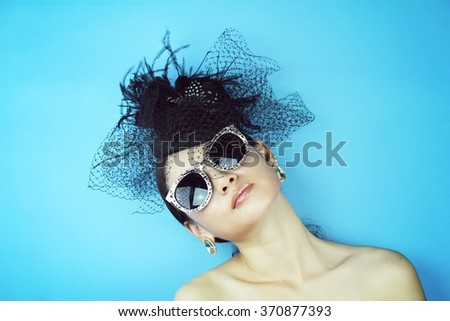 Retro Woman Portrait. Vintage Style Girl Wearing Old fashioned Hat, Beautiful black hat with feathers. Romantic Beauty, Retro Style.  - stock photo