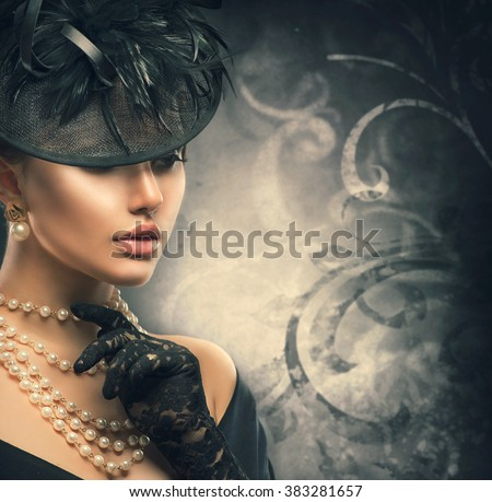Retro Woman Portrait. Vintage Style Girl Wearing Old fashioned Hat, gloves, pearls necklace and earrings, retro Hairstyle and Make-up. Romantic lady over black background. Pearl Jewellery - stock photo