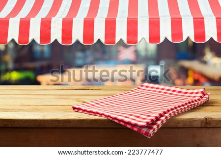 Retro wooden counter with tablecloth and awing for product montage display - stock photo