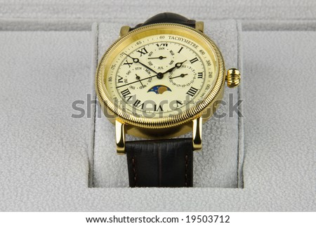 Retro wristwatch in gift box - stock photo