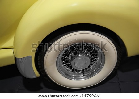 retro yellow car. close-up of old-fashioned gum-dipped  tires - stock photo