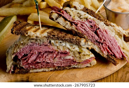 Reuben Sandwich, classic served with corned beef, Swiss cheese, sauerkraut, thousand island dressing on grilled rye bread. - stock photo
