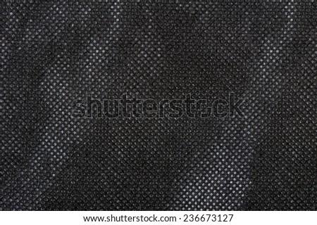 Reusable eco bag fabric sheet, black cloth textured surface, woven fiber rough abstract in horizontal orientation, no digitally altered - stock photo