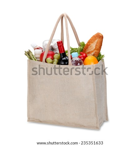 Reusable shopping bag full of groceries isolated on white background / clipping path - stock photo