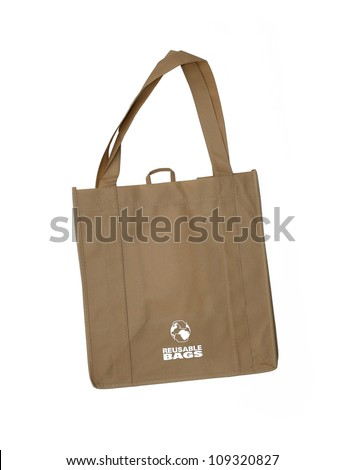 Reusable shopping bag with recycle symbol isolated on white background - stock photo