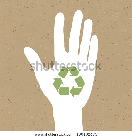 Reuse sign on hand silhouette on recycled paper. Raster version, vector file available in portfolio. - stock photo
