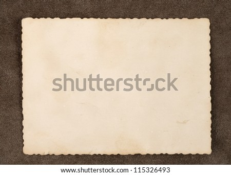 Reverse side of an old photo print with a decorative border on brown background - stock photo